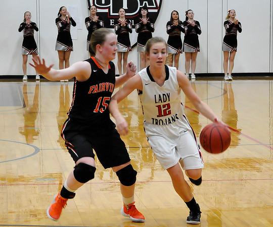 OBA's Savannah Price drives toward the basket against Fairview's Sydney Hutchison Tuesday January 26, 2016 at the Oklahoma BIble Academy gym. (Billy Hefton / Enid News & Eagle)