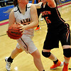 Alva's Ally Riley looks for an outlet while being defended by Fairview's Sydney Hutchinson during the championship game of the Wheat Capital Basketball Tournament Saturday January 9, 2016 at Chisholm High School. Alva defeated Fairview 66-53 to win the title. (Billy Hefton / Enid News & Eagle)