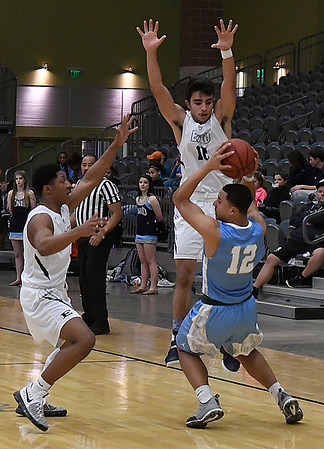 Enid's Will Phillips and Orion Tafoya pressures Lawton Ike's R.J. Fisher Saturday January 28, 2017 at the Central National Bank Center. (Billy Hefton / Enid Nedws & Eagle)