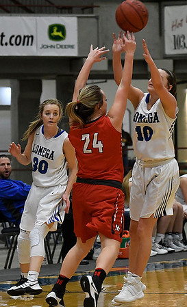 Lomega's Kenzi Lamer and Gracie Petty pressure Medford's Bailey Cless during the opening round of the Cherokee Strip Basketball Tournament Thursday January 19, 2017 at the Chisholm Trail Expo Center. (Billy Hefton / Enid News & Eagle)