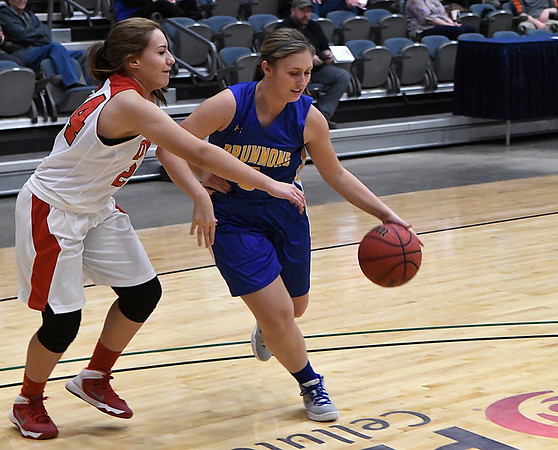 Drummond's Hannah Butler dribble by Dover's Cinthia Montes during the 93rd Skeltur Conference Basketball Tournament January 18, 2017 at the Central National Bank Center. (Billy Hefton / Enid News & Eagle)