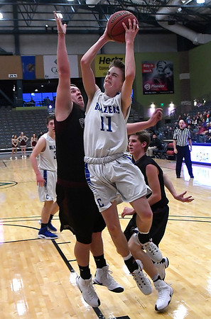Cimarron's Josiah Wood goes to be basket against Pioneer during the semi-finals of the 93rd Skeltur Conference Basketball Tournament Thursday January 19, 2017 at the Central National bank Center. (Billy Hefton / Enid News & Eagle)