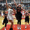 Alva's Cathy Mapes puts up a shot in the lane against Fairview's Bristin Grove during the semi-finals of the Wheat Capital Basketball Tournament Friday January 6, 2017 at Chisholm High School. (Billy Hefton / Enid News & Eagle)