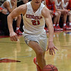 Chisholm's Scott Grebe drives towards the lane against Alva during the Wheat Capital Basketball Tournament Thursday January 5, 2017 at Chisholm High School. (Billy Hefton / Enid News & Eagle)