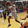 Kingfisher's Marco Charqueno turns toward the basket for a shot against Alva during the finals of the Wheat Capital Basketball Tournament Saturday January 7, 2017 at Chisholm High School. (Billy Hefton / Enid News & Eagle)
