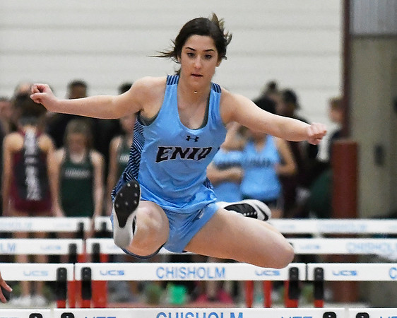 Enid's Lauren Jackson runs the 55 meter hurdles during an indoor track meet at the Chisholm Trail Expo Center Friday January 27, 2017. (Billy Hefton / Enid News & Eagle)