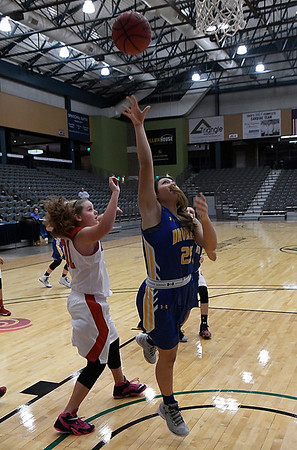 Drummond's Bella Cutruzzula puts up a shot against Dover during the 93rd Skeltur Conference Basketball Tournament January 18, 2017 at the Central National Bank Center. (Billy Hefton / Enid News & Eagle)