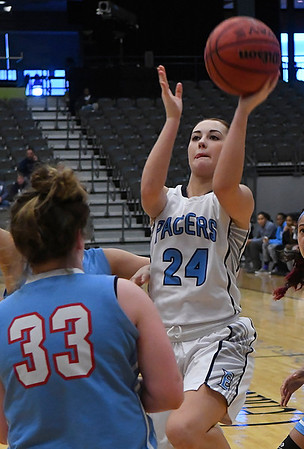 Enid's Izzy Plunkett shoots over Lawton Ike's Ginger Reece Saturday January 28, 2017 at the Central National Bank Center. (Billy Hefton / Enid Nedws & Eagle)