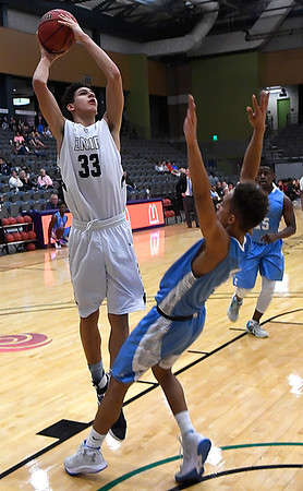 Enid's Cyson Mathis shoots over a falling DeShawn Becton of Lawton Ike Saturday January 28, 2017 at the Central National Bank Center. (Billy Hefton / Enid Nedws & Eagle)