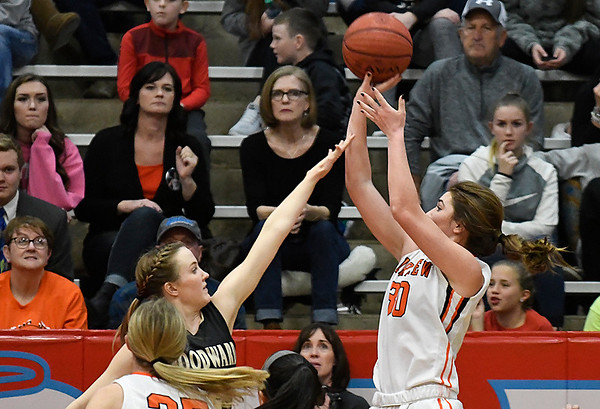 Fairview's Maddie Mason shoots over Woodward's Gracen Williamson during the finals of the Wheat Capital Basketball Tournament Saturday January 7, 2017 at Chisholm High School. (Billy Hefton / Enid News & Eagle)