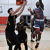 NOC Enid's Dyaire Holt puts up a shot over Spencer Lindsey of Redlands CC Thursday January 12, 2017 at the NOC Mabee Center. (Billy Hefton / Enid News & Eagle)