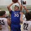 Covington-Douglas' Dalton James shoots over Pioneer's Michael Gehay and Chris Faw Faw Tuesday January 10, 2016 at Pioneer High School. (Billy Hefton / Enid News & Eagle)