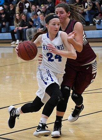 Madie Myers of Waukomis drives to the basket against Pioneer's Lexi Booth Friday January 27, 2017 at Waukomis High School. (Billy Hefton / Enid News & Eagle)