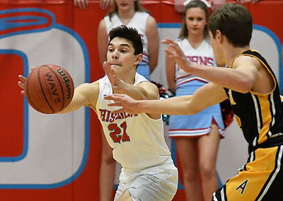 Chisholm's Scott Grebe intercepts a pass in front of Alva's T.W. Beiswanger during the Wheat Capital Basketball Tournament Thursday January 5, 2017 at Chisholm High School. (Billy Hefton / Enid News & Eagle)
