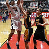 Kingfisher's Marco Charqueno shoots over Alva's T.W. Beiswanger and Ethan Harzman during the finals of the Wheat Capital Basketball Tournament Saturday January 7, 2017 at Chisholm High School. (Billy Hefton / Enid News & Eagle)