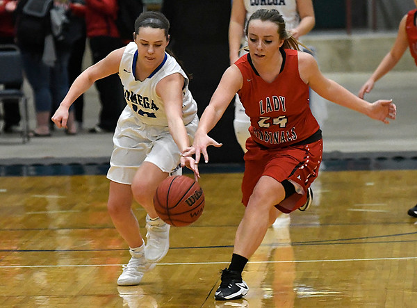Lomega's Kenzi Lamer outraces Medford's Bailey Cless to a loose ball during the opening round of the Cherokee Strip Basketball Tournament Thursday January 19, 2017 at the Chisholm Trail Expo Center. (Billy Hefton / Enid News & Eagle)