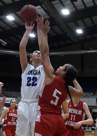 Lomega's Rachel Yost shoots over Kremlin Hillsdale's Jazzy Stubblefield during the finals of the Cherokee Strip Conference Basketball Tournament Saturday january 21, 2017 at the Chisholm Trail Expo Center. (Billy Hefton / Enid News & Eagle)