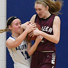 Slater Eck of Waukomis and Pioneer's Madison Postier tie up the ball Friday January 27, 2017 at Waukomis High School. (Billy Hefton / Enid News & Eagle)
