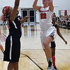 NOC Enid's Krisha Young goes up for a shot against Seminole's Alaisha Castleberry Thursday January 26, 2017 at the NOC Mabee Center. (Billy Hefton / Enid News & Eagle)