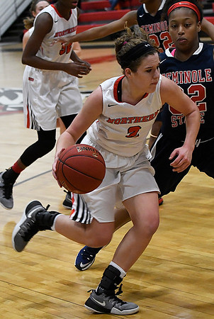 NOC Enid's Sarah Garvie drives towards the basket against Seminole's Torri Tarkington Thursday January 26, 2017 at the NOC Mabee Center. (Billy Hefton / Enid News & Eagle)