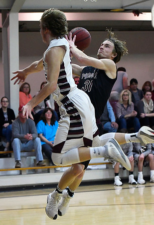 Pioneer's Aaron Gabriel lets Garber's Dayne Fuxa fly by as he goes up for a layup Tuesday January 31, 2017 at Garber High School. (Billy Hefton / Enid News & Eagle)