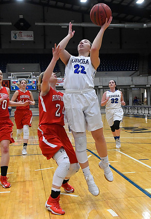 Lomega's Rachel Yost shoots over Ringwood's Abigail Anderson during the semi-finals of the Cherokee Conference Basketball Tournament Friday January 20, 2017 at the Chisholm Trail Expo Center. (Billy Hefton / Enid News & Eagle)