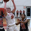 NOC Enid's Carley Frymire puts up a shot against Seminole's Kaiygen Stubblefield and Kourtney Jones Thursday January 26, 2017 at the NOC Mabee Center. (Billy Hefton / Enid News & Eagle)