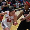 NOC Enid's Krisha Young drives towards the basket against Seminole's Alaisha Castleberry Thursday January 26, 2017 at the NOC Mabee Center. (Billy Hefton / Enid News & Eagle)
