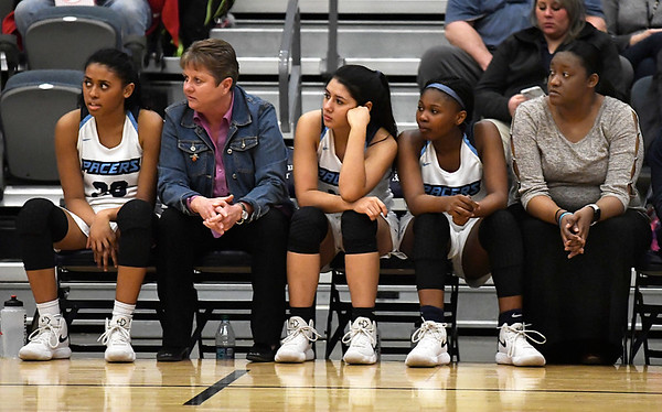 Enid Pacer coaches, Christie Buckner and Natasha Flynn, watch the game action with players Friday January 26, 2018. (Billy Hefton / Enid News & Eagle)