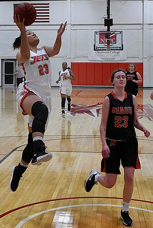 NOC Enid's Tanara Combs scores on a fastbreak against Mid American Christian University JV Tuesday January 9, 2018 at the NOC Mabee Center. (Billy Hefton / Enid News & Eagle)