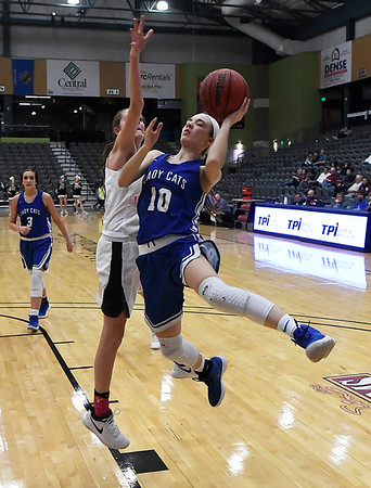 Covington-Douglas' Victoria Vandiver goes against Pond Creek-Hunter's Lexi Tracy during the third place game in the 94th Annual Skeltur Conference Basketball Tournament Friday January 19, 2018 at the Central National Bank Center. (Billy Hefton / Enid News & Eagle)