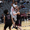 Enid's Will Phillips makes a pass while defended by Putnam City North's Blake Owens and J'veon Pierce Tuesday January 30, 2018 at the Central National Bank Center. (Billy Hefton / Enid News & Eagle)