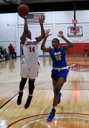 NOC Enid's Euresia Brown scores against NEO's Mariam Gnanou Monday January 22, 2018 at the NOC Mabee Center. (Billy Hefton / Enid News & Eagle)