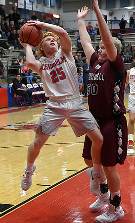 Chisholm's T.C. Smith goes up against Blackwell's Kendall Burtner during the opening round of the 48th Annual Wheat Capital Basketball Tournament Thursday January 4, 2018 at Chisholm High School. (Billy Hefton / Enid News & Eagle)