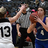 Covington-Douglas' Bre Rhoades readies to shoot over Pond Creek-Hunter's Lauren Tefft during the third place game in the 94th Annual Skeltur Conference Basketball Tournament Friday January 19, 2018 at the Central National Bank Center. (Billy Hefton / Enid News & Eagle)