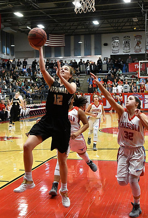 Woodward's Brennley Cloyd scores a fast break basket ahead of Chisholm's Tatum Sefcik during the semi finals of the 49th Wheat Capital Basketball Tournament Friday January 5, 2018 at Chisholm High School. (Billy Hefton / Enid News & Eagle)