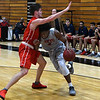 NOC Enid's Sebastian Gray drives against Seminole State's Cameron Kennedy Thursday January 25, 2018 at the NOC Mabee Center. (Billy Hefton / Enid News & Eagle)