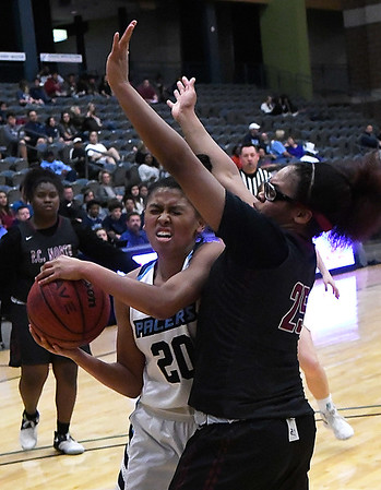 Enid's Tia Jackson runs into Putnam City North's Talia Lawson while driving to the basket Tuesday January 30, 2018 at the Central National Bank Center. (Billy Hefton / Enid News & Eagle)