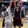Garber's Dayne Fuxa shoots over Drummond's Jack Boedecker Thursday January 18, 2018 during a semi final game of the 94th Annual Skeltur Conference Basketball Tournament at the Central National Bank Center. (Billy Hefton / Enid News & Eagle)
