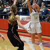 Kingfisher's Rilee Barton shoots over Fairview's Lexie Reihm during the semi finals of the 49th Wheat Capital Basketball Tournament Friday January 5, 2018 at Chisholm High School. (Billy Hefton / Enid News & Eagle)
