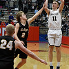 Kingfisher's Jett Sternberger shoots against Alva's Jacob Faulkner and Lane Scarbrough during the semi finals of the 49th Wheat Capital Basketball Tournament Friday January 5, 2018 at Chisholm High School. (Billy Hefton / Enid News & Eagle)