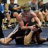 Enid's Austin Hisey wrestles Putnam City's Isaac Martinez on his way to a technical fall win Tuesday January 9, 2018 at Waller Middle School. (Billy Hefton / Enid News & Eagle)