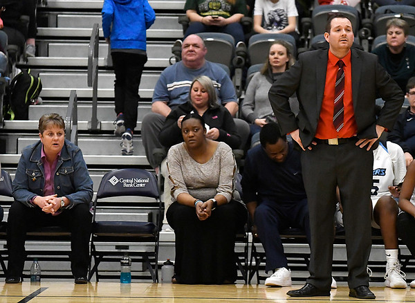 Enid Pacer coaches, Gerrett Spears (head coach), and assistances Christie Buckner and Natasha Flynn, watch the game action with players Friday January 26, 2018. (Billy Hefton / Enid News & Eagle)