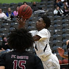 Enid's Carlos Menefield puts a shot in the lane against Putnam City North's Shayon Janloo and J'veon Pierce Tuesday January 30, 2018 at the Central National Bank Center. (Billy Hefton / Enid News & Eagle)