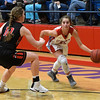 Chisholm's Briley Yunker drives against Oklahoma Bible Academy's Elizabeth Monday January 29, 2018 at Chisholm High School. (Billy Hefton / Enid News & Eagle)