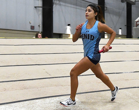 Enid's Maria Hernandez runs the anchor leg of the 4 x 800 relay Friday January 26, 2018 at the Chisholm Trail Expo Center. (Enid News & Eagle)