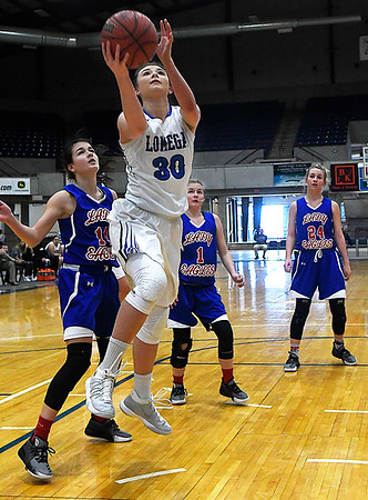 Lomega's Alyssa Smalley scores a basket against DCLA during the opening game of the Cherokee Strip Conference Basketball Tournament Thursday January 18, 2018 at the Chisholm Trail Expo Center. (Billy Hefton / Enid News & Eagle)