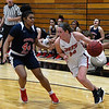 NOC Enid's Andi Pierce drives pass Seminole State's Kaci Richardson Thursday January 25, 2018. (Billy Hefton / Enid News & Eagle)