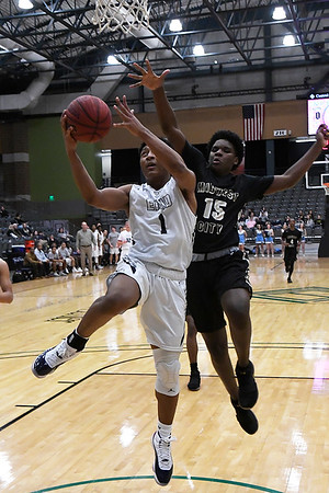 Enid's Will Phillips goes in for a basket ahead of Midwest City's Jacobi Johnson Friday January 26, 2018 at the Central National Bank Center. (Billy Hefton / Enid News & Eagle)