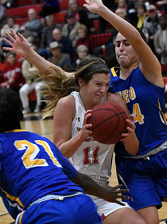 NOC Enid's McKenna Pulley drives through the lane against NEO's Eneritz Larranaga Monday January 22, 2018 at the NOC Mabee Center. (Billy Hefton / Enid News & Eagle)